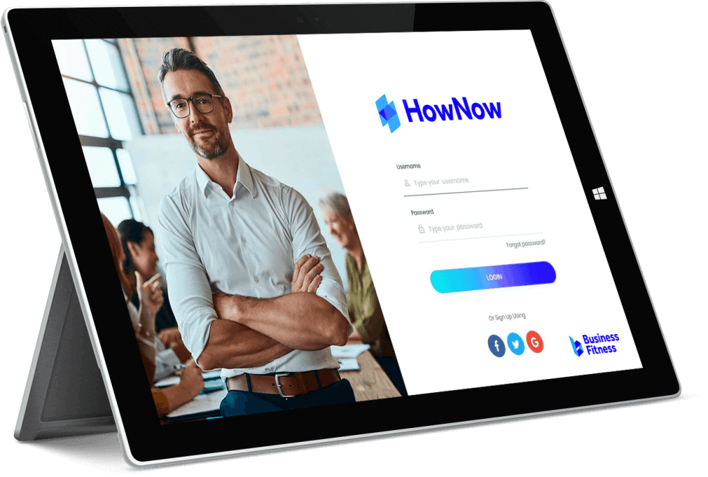 HowNow login page displayed on a Microsoft surface tablet